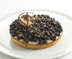 Blueberry tart with rice pudding photo