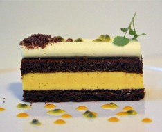 Biscuit of dark chocolate with mango and passion fruit cream photo