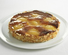 Traditional pear pie with cashew and caramel photo