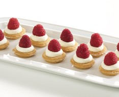 Tartellete with cream custard and raspberries photo